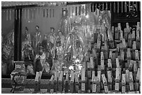 Statues and sticks, Kuan Yin Teng temple. George Town, Penang, Malaysia ( black and white)