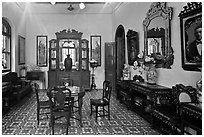 Room with furniture inside Pinang Peranakan Mansion. George Town, Penang, Malaysia ( black and white)