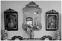 Portraits and mirors, Pinang Peranakan Mansion. George Town, Penang, Malaysia ( black and white)