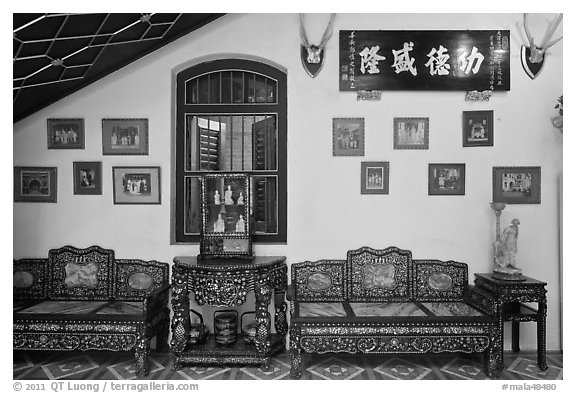 Antique furniture and images, Pinang Peranakan Mansion. George Town, Penang, Malaysia (black and white)