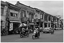 Chinatown street with traffic and storehouses. George Town, Penang, Malaysia (black and white)