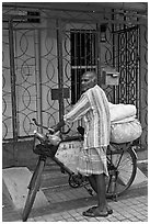 Malay with loaded bicycle. George Town, Penang, Malaysia ( black and white)