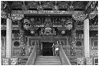 Women standing at Khoo Kongsi entrance. George Town, Penang, Malaysia (black and white)