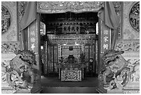Carved stone dragons and main hall, Khoo Kongsi. George Town, Penang, Malaysia (black and white)