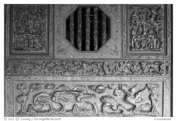 Octogonal window and stone carvings, Khoo Kongsi. George Town, Penang, Malaysia (black and white)