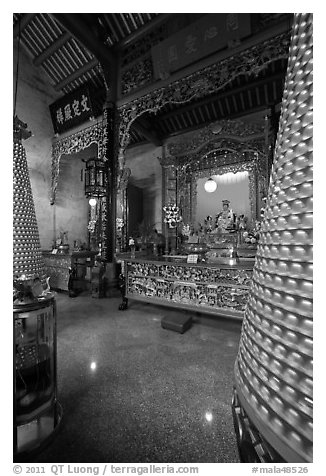 Altar and wheels in motion, Hainan Temple. George Town, Penang, Malaysia (black and white)