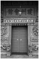 Crimson door and slate wall, Hainan Temple. George Town, Penang, Malaysia (black and white)