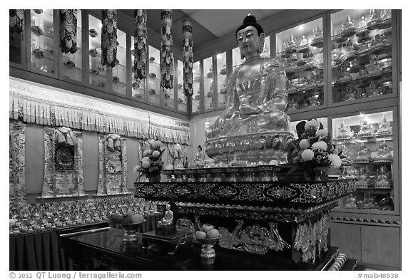 Buddha image inside Yellow Hat Buddhist temple. George Town, Penang, Malaysia (black and white)