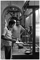 Man preparing nan bread in arcade. George Town, Penang, Malaysia (black and white)