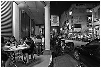 Eating on the street at night. George Town, Penang, Malaysia (black and white)