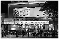 Movie theater showing Bollywood films at night. George Town, Penang, Malaysia (black and white)