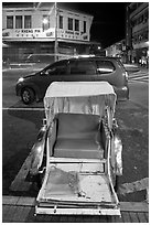 Rickshaw and auto at night. George Town, Penang, Malaysia ( black and white)