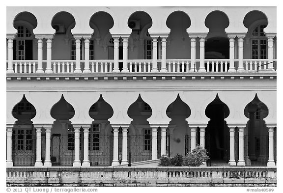 Facade with islamic style arches. Kuala Lumpur, Malaysia (black and white)