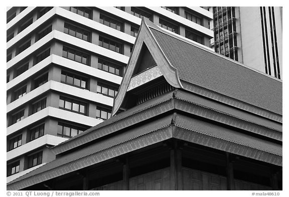 Roof of traditional tek house and modern buildings. Kuala Lumpur, Malaysia (black and white)