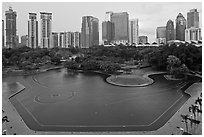 KLCC Park surrounded by high-rise towers. Kuala Lumpur, Malaysia (black and white)