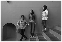 Young women with islamic headscarfs and modern fashions. Malacca City, Malaysia (black and white)
