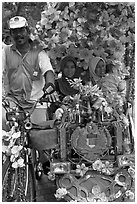 Decorated trishaw driver and passengers. Malacca City, Malaysia (black and white)
