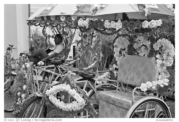 Trishaws decorated with plastic flowers. Malacca City, Malaysia (black and white)