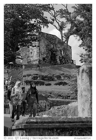Malay tourists descend stairs from St Paul Hill. Malacca City, Malaysia (black and white)