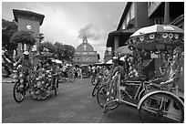 Trishaws, clock tower, and church. Malacca City, Malaysia (black and white)