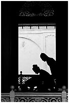 Silhouettes of men bowing in worship, Masjid Kampung Hulu. Malacca City, Malaysia ( black and white)
