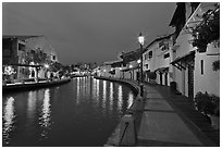 Houses and walkway at dusk, Melaka River. Malacca City, Malaysia ( black and white)