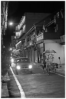 Car and bicycle rickshaw at night. Malacca City, Malaysia (black and white)