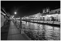 Melaka River at night with St Peters Church towers. Malacca City, Malaysia ( black and white)
