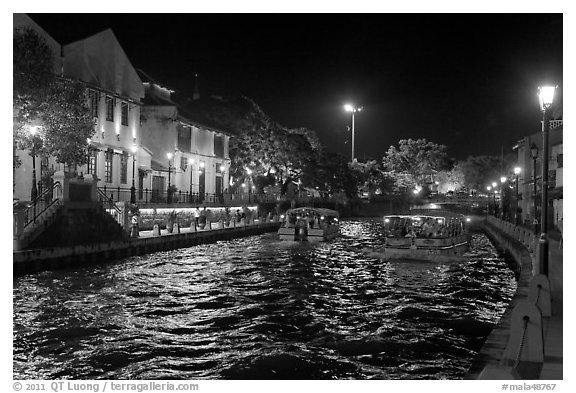 Tour boats on Melaka River at night. Malacca City, Malaysia (black and white)