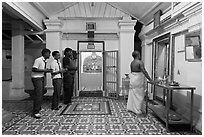Worhipers and holy man, Sri Poyyatha Vinayagar Moorthi Temple. Malacca City, Malaysia (black and white)