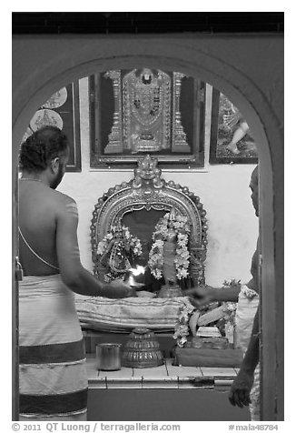 Holy men lighting fire, Sri Poyyatha Vinayagar Moorthi Temple. Malacca City, Malaysia (black and white)
