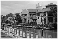 Lamps, riverside houses and St Peters Church towers. Malacca City, Malaysia ( black and white)