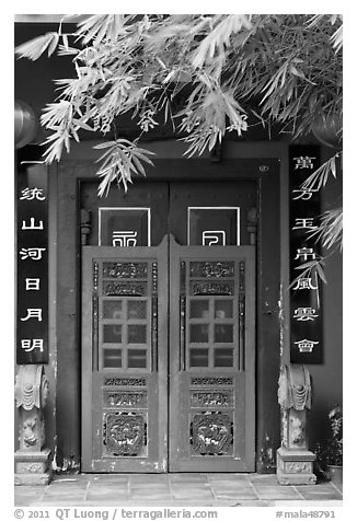 Weathered door with chinese signs and lanterns. Malacca City, Malaysia (black and white)