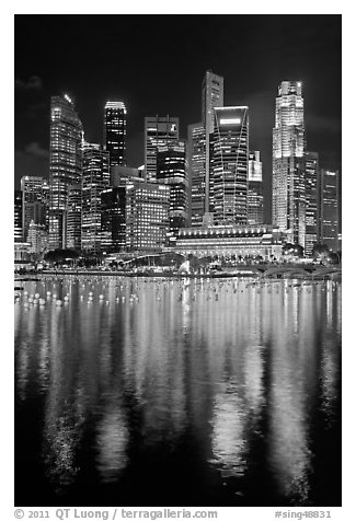 Fullerton Hotel and skyline at night. Singapore (black and white)