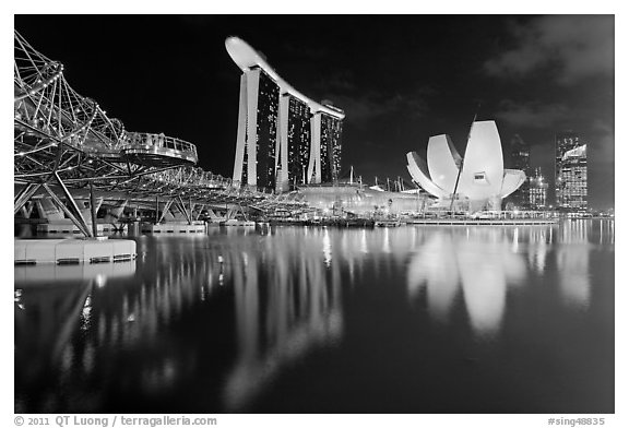 Helix Bridge, Marina Bay Sands, and ArtScience Museum at night. Singapore (black and white)