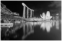 Helix Bridge, Marina Bay Sands, and ArtScience Museum at night. Singapore ( black and white)