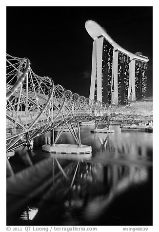 Helix Bridge and Marina Bay Sands hotel at night. Singapore (black and white)