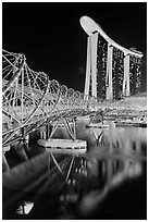 Helix Bridge and Marina Bay Sands hotel at night. Singapore ( black and white)