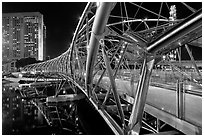 Double Helix Bridge in Marina Bay at night. Singapore (black and white)