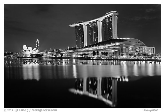 Marina Bay Sands resort and bay reflection at night. Singapore (black and white)