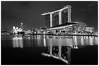 Marina Bay Sands resort and bay reflection at night. Singapore ( black and white)