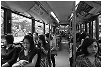 Riding a bus. Singapore ( black and white)