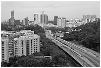 Freeway bordered by parklands and high rises. Singapore (black and white)