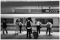 Passengers preparing to board MRT train. Singapore (black and white)