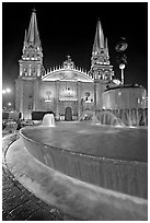 Fountain on Plazza de los Laureles and Cathedral by night. Guadalajara, Jalisco, Mexico ( black and white)