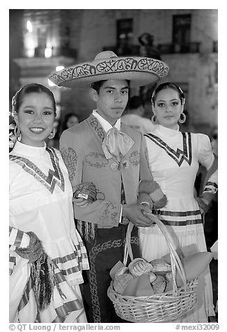 Man with sombrero hat surrounded by  two women. Guadalajara, Jalisco, Mexico