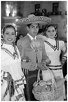 Man with sombrero hat surrounded by  two women. Guadalajara, Jalisco, Mexico (black and white)