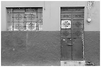 Multicolored wall, window, and door. Guadalajara, Jalisco, Mexico (black and white)