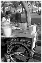 Food vendor with a wheeled food stand. Guadalajara, Jalisco, Mexico (black and white)