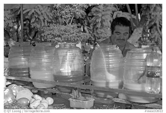 Multicolored drinks offered on a street stand. Guadalajara, Jalisco, Mexico (black and white)